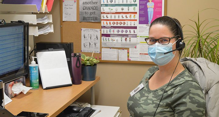 Chelsea Burnell, Telehomecare nurse at Osler, sits at her desk
