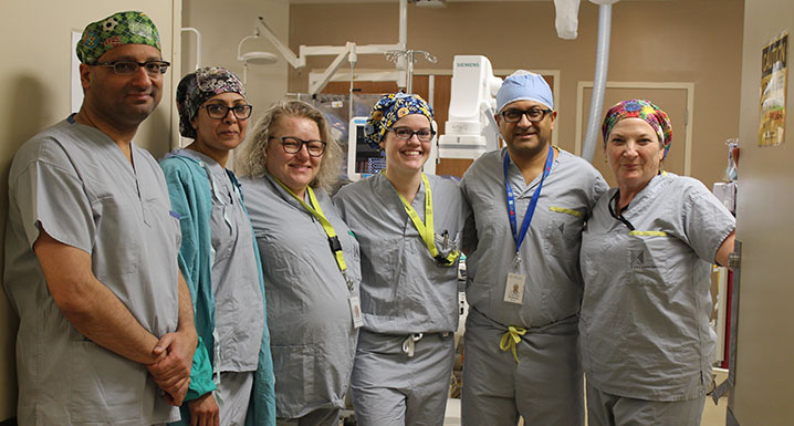 Some members of Brampton's Civic cardiac team pose outside one of the hospital's Cath Labs where they perform a highly-advanced, minimally-invasive procedure one day a month for patients experiencing chronic chest pain
