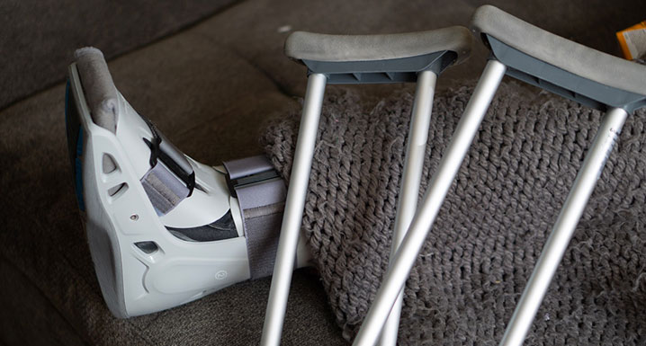 A set of crutches and a walking cast