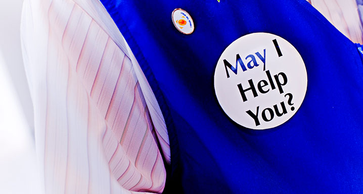 Pin on volunteer vest that reads may I help you?