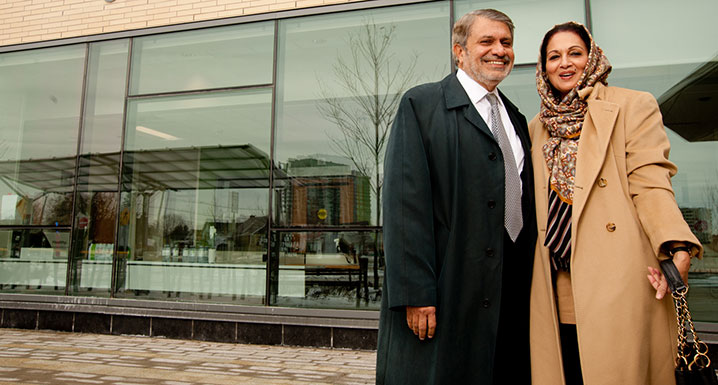 Sajjad Ebrahim and his wife in front of Peel Memorial's Urgent Care Centre