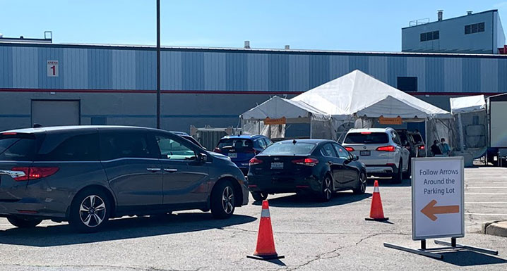 Cars line up at the South Fletchers Drive-Thru Assessment Centre
