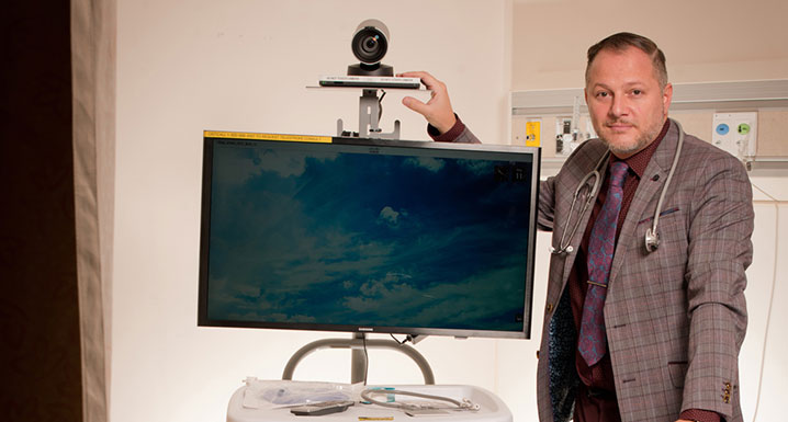 Osler physician with a virtual care camera and monitor stand
